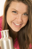 Happy portrati of female model holding a metal water bottle Stock Photo