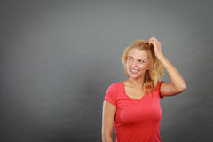 Happy positive blonde woman gesturing hands Royalty Free Stock Photos