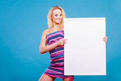 Happy positive blonde woman holding blank white board Stock Photography