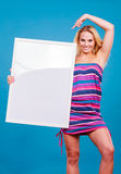 Happy positive blonde woman holding blank white board Stock Photos