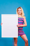 Happy positive blonde woman holding blank white board Stock Images