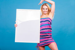 Happy positive blonde woman holding blank white board Royalty Free Stock Images