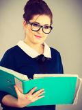 Happy positive business woman holding binder with documents Royalty Free Stock Image