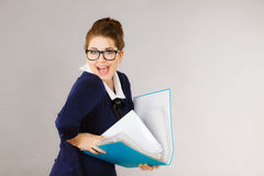 Happy positive business woman holding binder with documents Royalty Free Stock Images