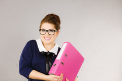 Happy positive business woman holding binder with documents Stock Photos