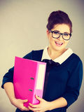 Happy positive business woman holding binder with documents Royalty Free Stock Photography