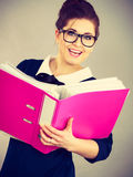 Happy positive business woman holding binder with documents Stock Photography