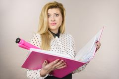 Happy positive business woman holding binder with documents Stock Image