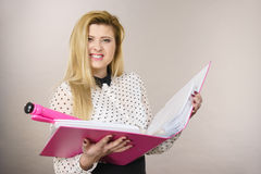 Happy positive business woman holding binder with documents Royalty Free Stock Photo