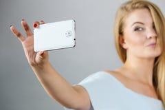 Happy woman taking selfie stock photography