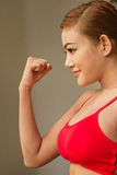 Happy, positive, confident woman in red sportswear Royalty Free Stock Photography