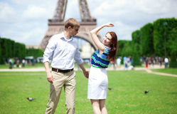 Happy positive couple dancing near the Eiffel tower Stock Photography