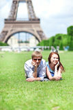 Happy positive couple laying on the grass Royalty Free Stock Images