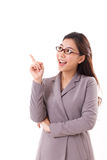 Happy, positive female business executive, business woman pointing up Stock Photos