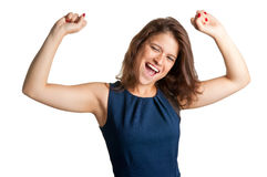 Happy Positive Girl. Young brunette smiling with her arms up in the air, isolated in a white background Royalty Free Stock Photography