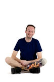 Happy positive male amputee. Sitting cross legged on the floor wearing his artificial limb or prosthesis Royalty Free Stock Photography