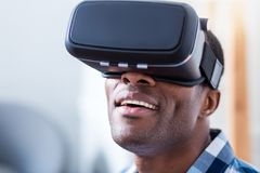 Happy positive man looking into 3d glasses Stock Photography
