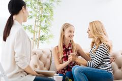 Happy positive mother and daughter holding hands Stock Images