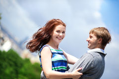 Happy positive romantic loving couple is hugging Royalty Free Stock Images