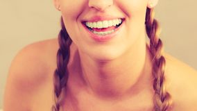 Happy positive smiling blonde woman. Happiness human face expressions concept. Happy positive cheerful smiling woman with blonde hair tied in braid Stock Images