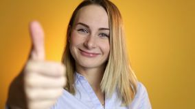 Happy positive smiling woman shows the thumbs-up looking in camera stock video footage