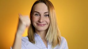 Happy positive smiling woman shows the thumbs-up looking in camera stock video