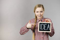 Happy positive woman holding idea sign Stock Photos