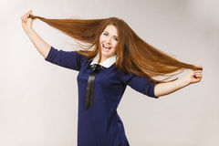 Happy positive woman with long brown hair Royalty Free Stock Image