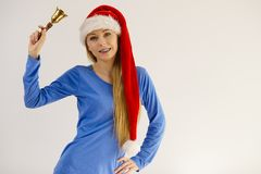Christmas woman holding bell. Stock Photo