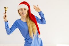 Christmas woman holding bell. Royalty Free Stock Images