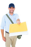 Happy postman delivering letter on white background Stock Photo