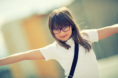 Happy pre-teen young girl. Cute little girl in the city on a sunny day. Portrait young girl. Toned image Stock Photography