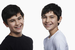 Happy Preadolescent Brothers Against White Background Stock Photography