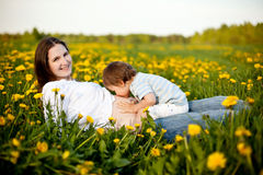 Happy pregnancy. Happy family: little son kissing stomach of his pregnant mother royalty free stock photography