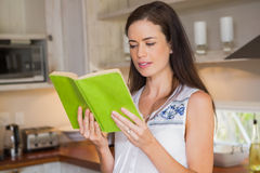 Happy pregnancy reading a book Royalty Free Stock Image