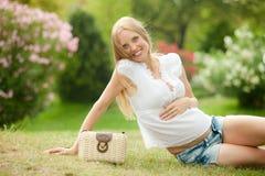 Happy pregnancy woman in summer meadow Royalty Free Stock Photos