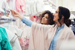 Happy pregnant woman shopping in baby store Stock Photo