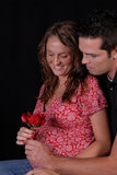 Happy and pregnant couple. Stock Image