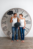 Happy Pregnant Couple dressed in white showing sign speech bubble banners Royalty Free Stock Photos