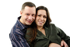 Happy pregnant couple hugging stock photos