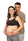 Happy pregnant couple  hugging Stock Photo