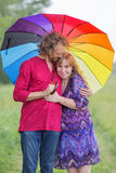 Happy pregnant couple hugging in nature Stock Image