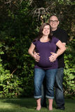 Happy pregnant couple outdoors Royalty Free Stock Photos