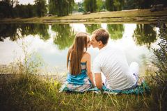 Happy pregnant Couple in the summer park stock photography