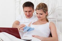 Happy pregnant family. Stock Photos
