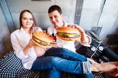 Happy pregnant family eating fast food Stock Photo