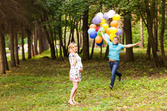Happy pregnant family having fun during the walk in summer nature. Royalty Free Stock Photo