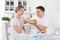 Happy pregnant family and healthy food Stock Photo