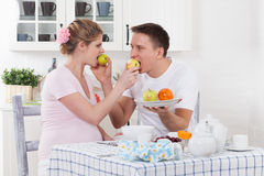 Happy pregnant family and healthy food Stock Photography