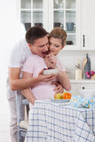 Happy pregnant family and healthy food Stock Photos
